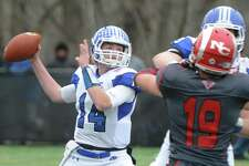 Darien quarterback Brian Peters throws a pass in Darien's 37-34 win over New Canaan in the Turkey Bowl high school football game at Dunning Stadium in New Canaan, Conn. Thursday, Nov. 24, 2016. New Canaan scored 24 unanswered points to tie the game and force an overtime. In overtime, Darien kicked a field goal to take the lead and forced a New Canaan interception to end the game, setting off a wild celebration as fans stormed the field.