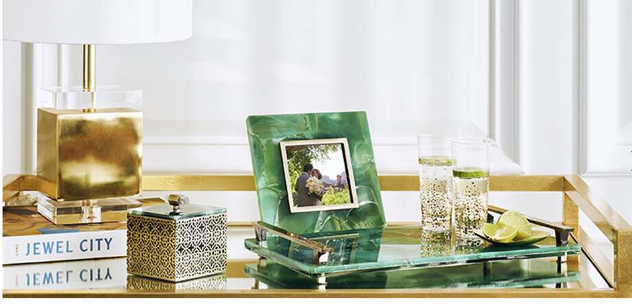 Designer Kendra Scott has launched her first home collection of trays, trinket boxes and photo frames.