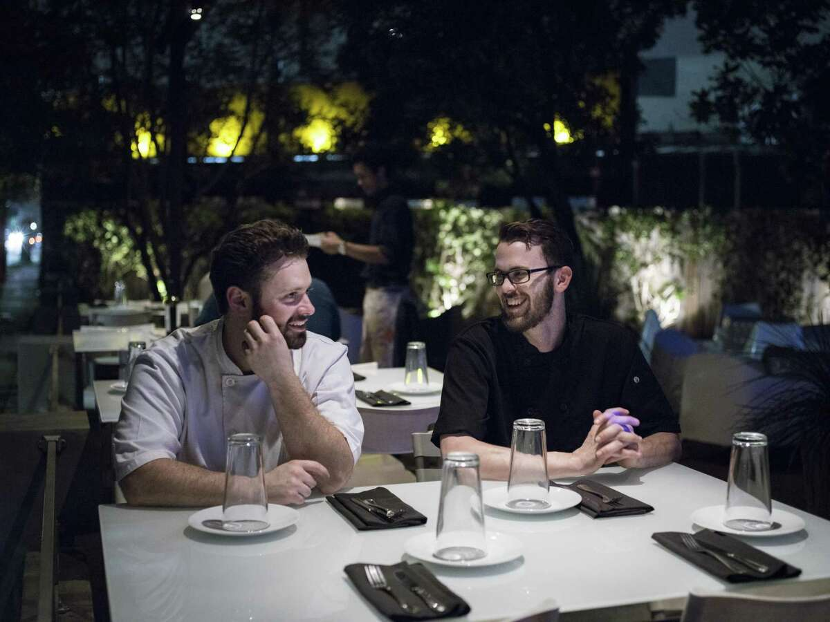 Head co-chefs Jared Smith, left, and Cody Clarke, right, on Feast's outdoor patio.