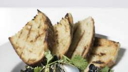 Prince Edward Island mussels with a country white sourdough loaf.