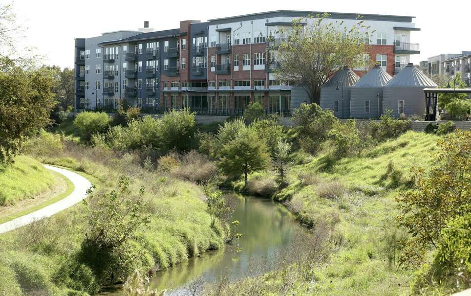 The Flats at Big Tex is a 7.5-acre apartment complex that occupies nearly a half-mile of the San Antonio River, linking the well-to-do streets of King William with areas farther south that are still untouched by the recent growth. Photo: William Luther /San Antonio Express-News / © 2016 San Antonio Express-News