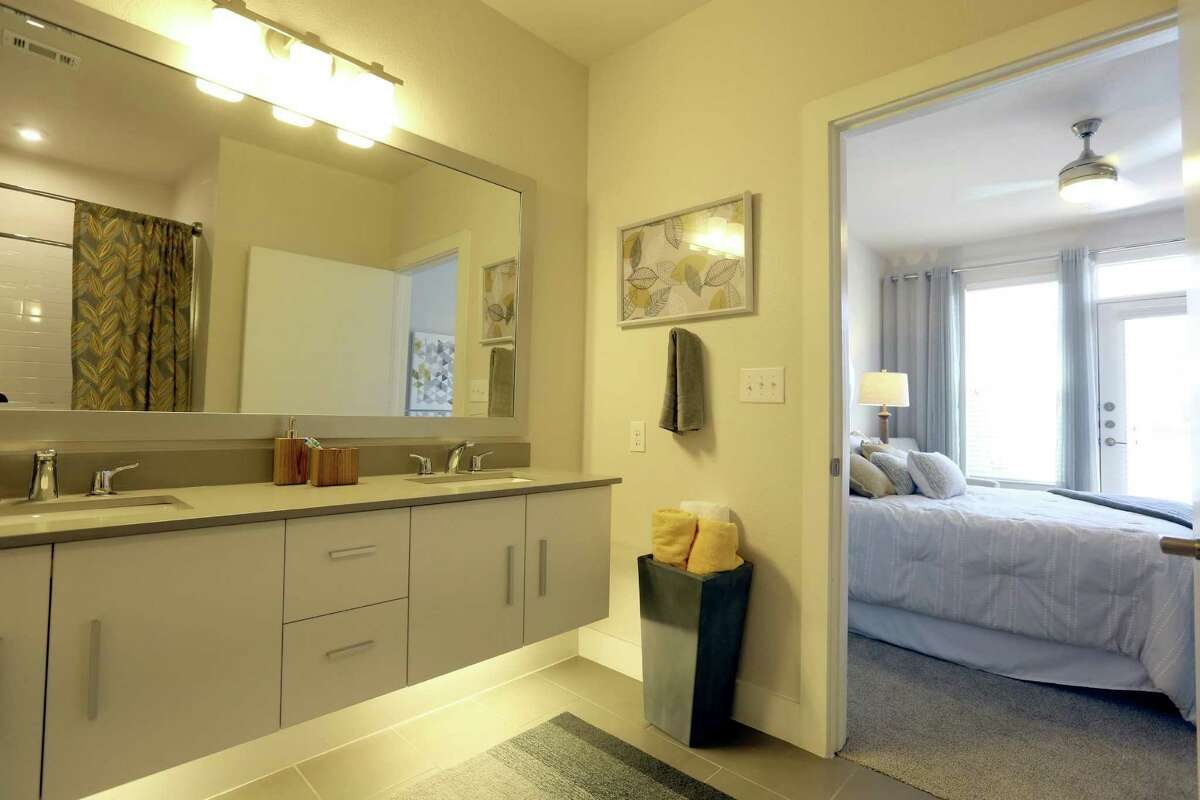 The master bath and master bedroom of a townhouse at The Flats at Big Tex.