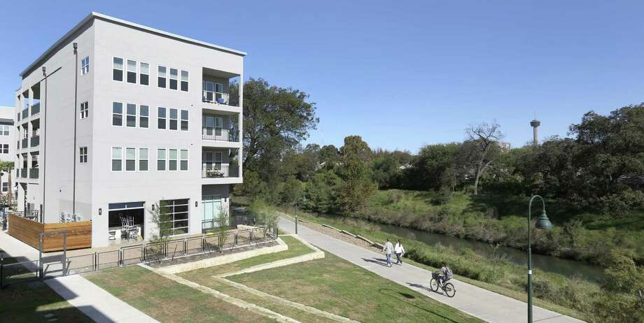 The Flats at Big Tex apartment complex opened last year on the Mission Reach section of the River Walk. Click ahead to see the top 10 San Antonio neighborhoods for rentals. Photo: William Luther /San Antonio Express-News / © 2016 San Antonio Express-News