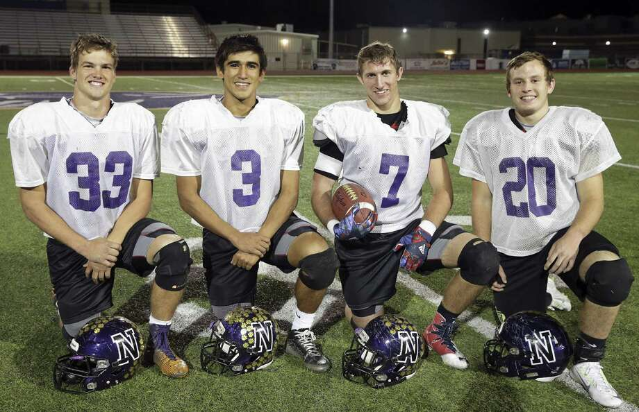 Ty Shelton (from left), Jared Leal, Jake Wright and Tanner Law — Navarro senior players who have been starters since their freshman year — gather after practice at the school on Nov. 29, 2016. Photo: Tom Reel /San Antonio Express-News / 2016 SAN ANTONIO EXPRESS-NEWS