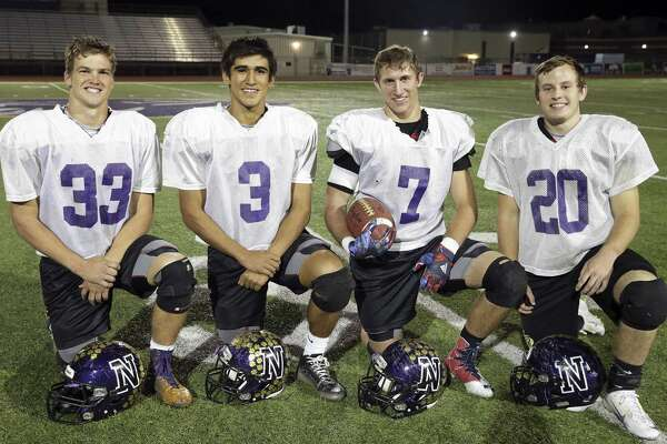 Ty Shelton (from left), Jared Leal, Jake Wright and Tanner Law — Navarro senior players who have been starters since their freshman year — gather after practice at the school on Nov. 29, 2016.