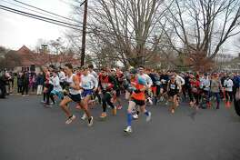Racers take off at the Pequot Road Race on Thanksgiving in Southport, Conn.