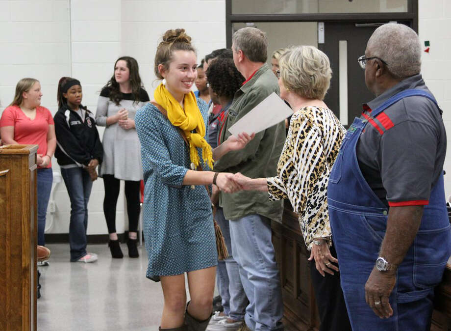 Varsity Volleyball Team player Sarah Heflin shook hands with COCISD Board President Barbara Moore and the other trustees at the regular school board meeting on Monday, Nov. 28. Photo: Submitted