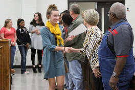 Varsity Volleyball Team player Sarah Heflin shook hands with COCISD Board President Barbara Moore and the other trustees at the regular school board meeting on Monday, Nov. 28.
