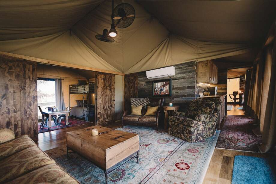 PHOTOS: Family moves into tent house in North TexasSaddleback Leather Company founder Dave Munson and his wife Suzette recently shared a behind the scenes look at their African Safari tent compound, which they moved into after selling off their own eight-bedroom Texas home. The North Texas compound is made up of four waxed canvas tents but this isn't your typical tent dwelling, as you can see in the photos.Click through to see what the rest of the place looks like... Photo: Saddleback Leather