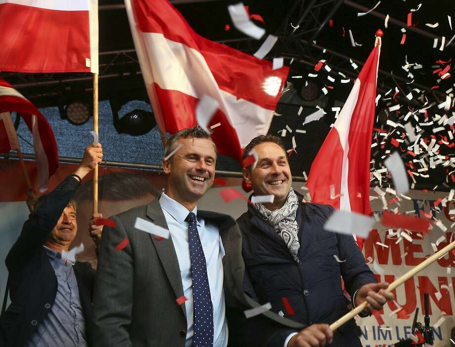 FILE - In this May 20, 2016 file photo Norbert Hofer candidate for presidential elections of Austria's Freedom Party, FPOE, and Heinz-Christian Strache, from left, head of Austria's Freedom Party, FPOE, look out at supporters during the final election campaign event in Vienna.  Austrians are choosing Sunday, Dec. 4, 2016 between a moderate and a populist for president _ and both candidates are hoping to exploit the Trump effect in the first European Union nation facing such a choice since the U.S election. (AP Photo/Ronald Zak, file) Photo: Ronald Zak, Associated Press