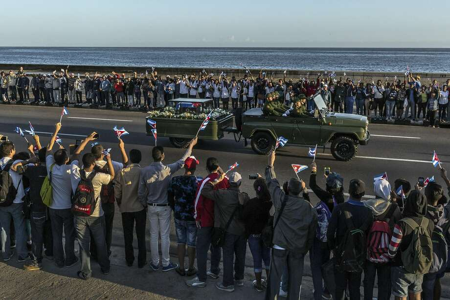 The ashes of the late Cuban leader are carried past crowds lined up along the seafront in Havana. Photo: MAURICIO LIMA, NYT