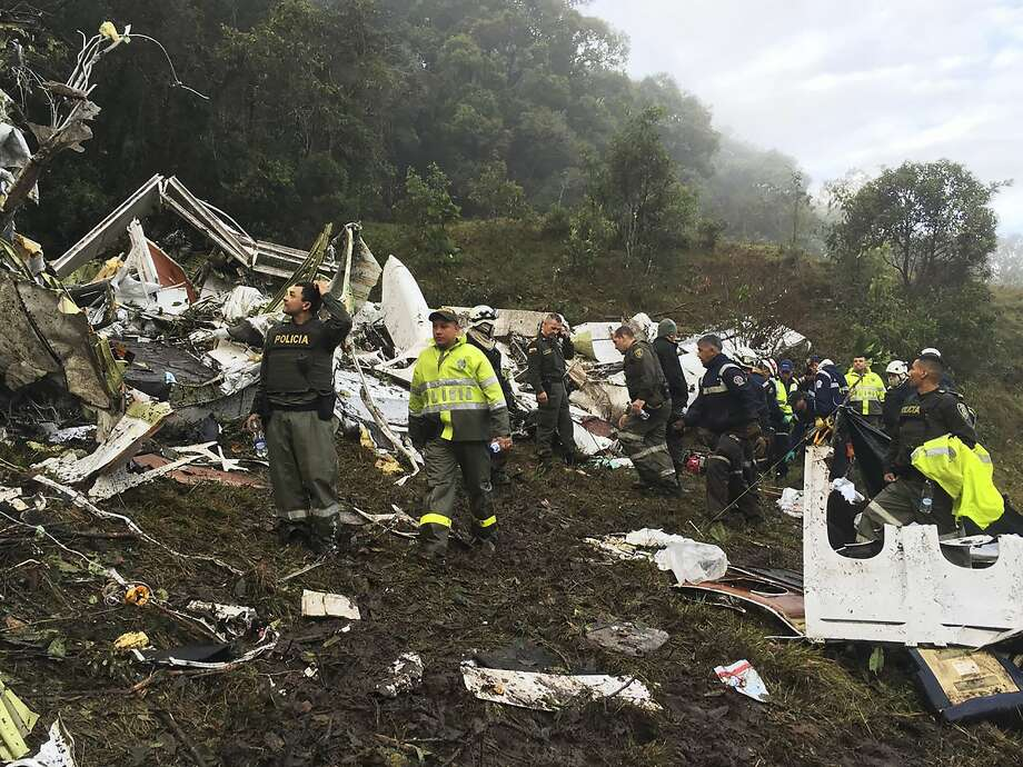 Rescue teams and police work at the site of a chartered airplane that crashed in a mountainous area outside the Colombian city of Medellin. Photo: Associated Press