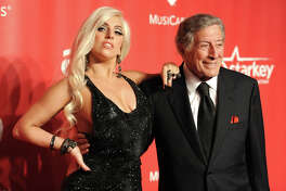 Lady Gaga, left, and Tony Bennett arrive at the 2015 MusiCares Person of the Year event at the Los Angeles Convention Center on Friday, Feb. 6, 2015 in Los Angeles.