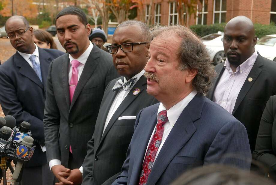 Attorney Charles Monnett and the family of Keith Lamont Scott address the media after their meeting with the district attorney, who told them he would not charge Officer Brentley Vinson. Photo: Davie Hinshaw, TNS