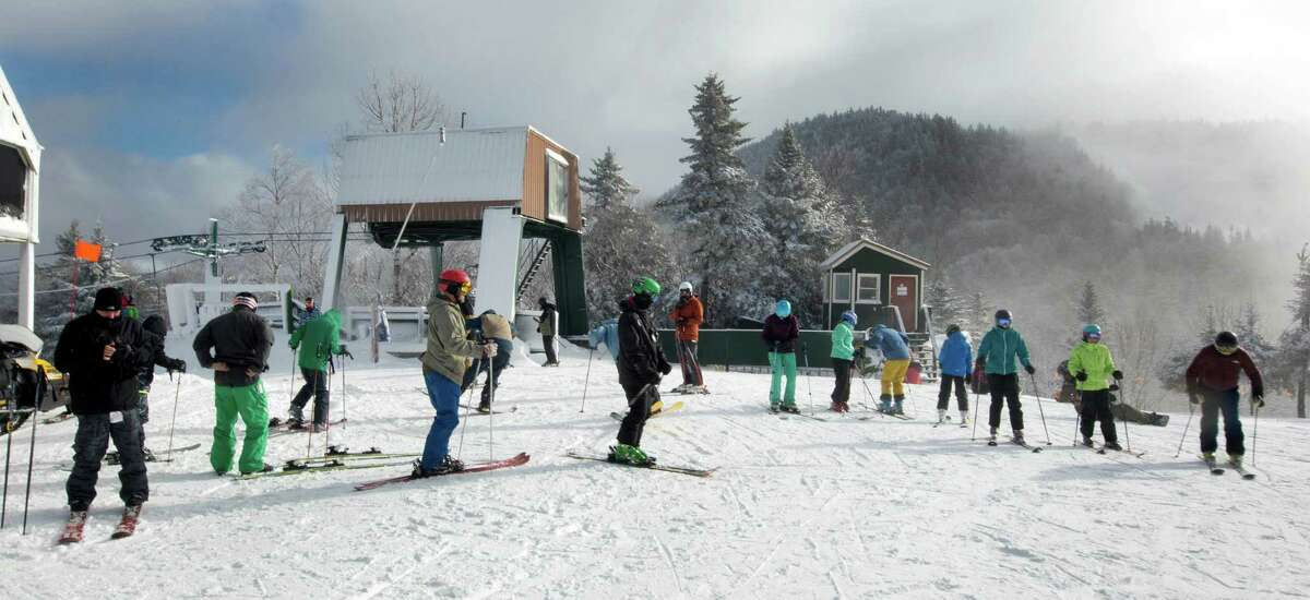 Skiers get ready to take the first run of the season on top of the mountain on opening day at Loon Mountain ski resort Wednesday, Nov. 23, 2016, in Lincoln, N.H.