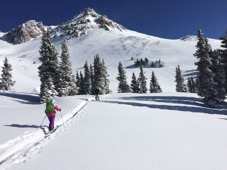 Participants in a Chicks With Stix backcountry ski trip head out for a day on the slopes above OPUS Hut near Ouray, Colo.