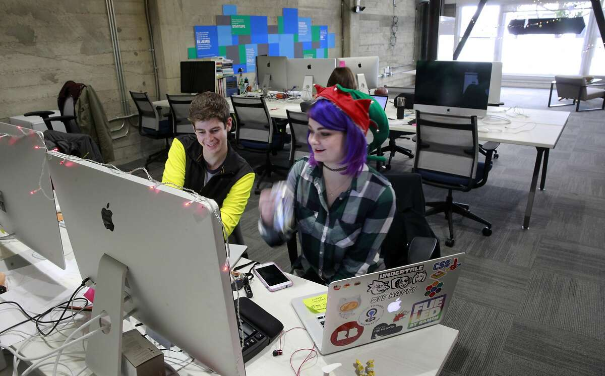Software developers Alex Emrie and Savannah Worth at work in the IBM Bluemix Garage workspace, one of the many companies that share space at the Galvanize learning community building in downtown San Francisco, California as seen on Wednesday November 30, 2016.