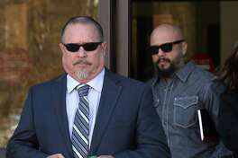 Bandidos motorcycle club president Jeff Pike, left, exits Wednesday, Nov. 30, 2016 the John H. Wood, Jr. Federal Courthouse in San Antonio after a hearing where he claimed his attorney has a conflict of interest and sought to get a new one.