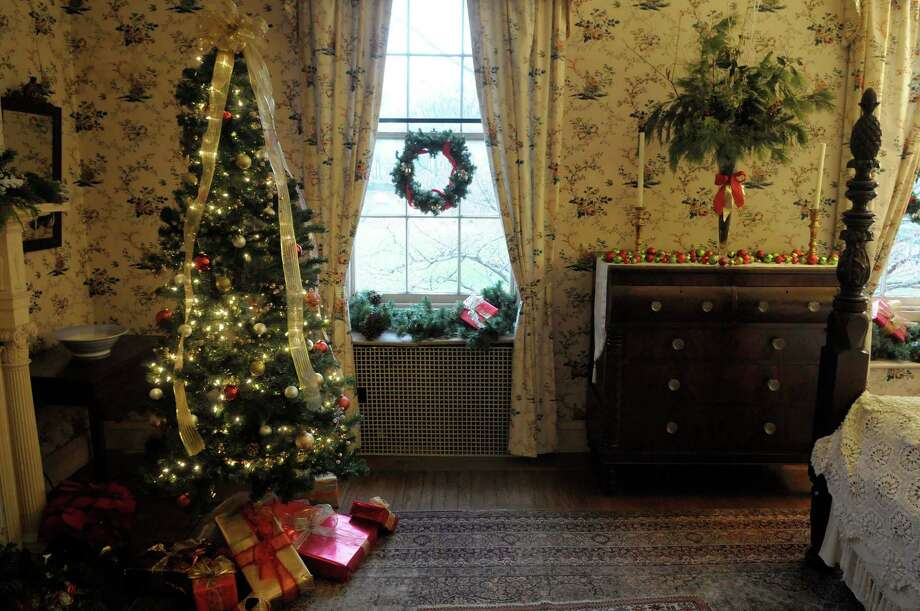 A view of one of the decorated upstairs bedrooms  in Albany, NY during the Holiday Tea   at Ten Broeck Mansion on Sunday, Dec. 12, 2010.  The yearly event is put on by the Albany County Historical Association, which operates the Mansion.  Because of the popularity of the event this year the Association held two sittings on Sunday.  The rooms in the mansion are decorated for the holidays by area groups.  This Thursday, Dec. 16th at 7pm, the Associate will hold Christmas Traditions at the mansion, a Italian holiday event of caroling and cookies and cakes.  On Saturday, Dec. 18th, the Association will hold the Holiday Madrigals event from 2pm - 4:30pm, and a children's story time from 10:30am till 12 noon.    (Paul Buckowski / Times Union) Photo: Paul Buckowski / 00011376A
