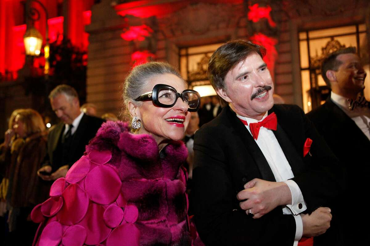 Joy Bianchi and John Rosin wait to cross the street to attend the performance of the San Francisco Ballet season-opening gala on Thursday, Jan. 24, 2013.