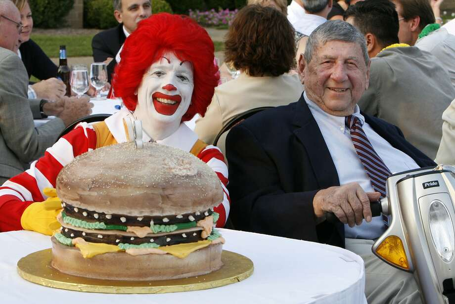 In this Aug. 21, 2008 file photo Big Mac creator Jim Delligatti, right, poses with a Big Mac birthday cake and Ronald McDonald at his 90th birthday party in Canonsburg, Pa. Photo: Gene J. Puskar, Associated Press
