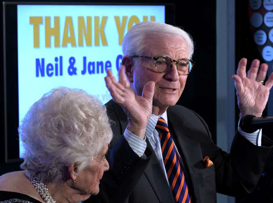 Neil Golub, with wife, Jane, speaks at a presentation where the pair were honored by the Museum of Innovation and Science (miSci) for their years of dedication to the museum on Wednesday, Nov. 30, 2016, in Schenectady, N.Y.   (Skip Dickstein/Times Union) Photo: SKIP DICKSTEIN / 20039002A