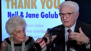 Neil Golub, with wife, Jane, speaks at a presentation where the pair were honored by the Museum of Innovation and Science (miSci) for their years of dedication to the museum on Wednesday, Nov. 30, 2016, in Schenectady, N.Y.   (Skip Dickstein/Times Union)