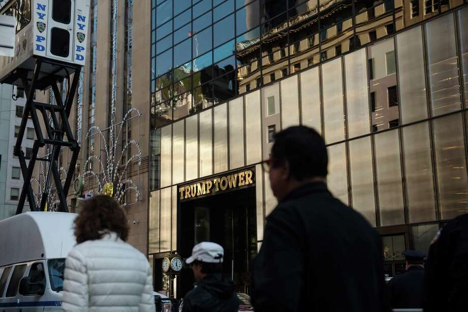 An entrance to Trump Tower, on Fifth Avenue in Manhattan on Nov. 16. President-elect Donald Trump's statement that he would take unspecified steps to separate himself from his vast business empire — made via Twitter on Nov. 30 — drew a swift rebuke from legal and ethics experts who said he was not doing enough to eliminate conflicts of interest. Photo: HILARY SWIFT /NYT / NYTNS