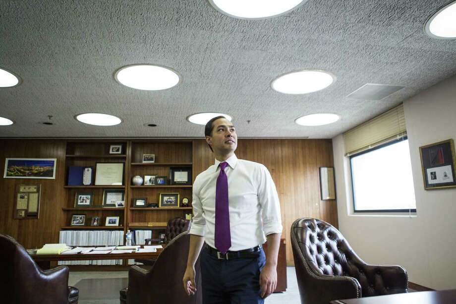 Julian Castro, the secretary of Housing and Urban Development, shows off the original style lights in his office on the 10th floor of Housing and Urban Development building in Washington, Aug. 8, 2016. The office has remained largely untouched and boasts the same style since the building was built shortly after the development of HUD in 1965. (Al Drago/The New York Times) Photo: AL DRAGO, STF / NYT / NYTNS