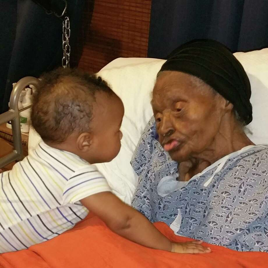 Callie Green, 107, right, and Benjamin Guillory, six months old Photo: Dan Wallach