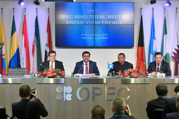 From left to right, Mohamed Hamel, chairman of OPEC, Mohammed Al-Sada, Qatar's minister of energy and industry and president of OPEC, Mohammed Barkindo, secretary general of OPEC, and Hasan Hafidh, head of public relations of OPEC, attend a news conference following the 171st Organization of Petroleum Exporting Countries (OPEC) meeting in Vienna, Austria, on Wednesday, Nov. 30, 2016. Oil rose the most in nine months after OPEC ministers were said to have forged a deal to cut production, sending stocks of energy producers and currencies of commodity-exporting nations higher. Photographer: Akos Stiller/Bloomberg