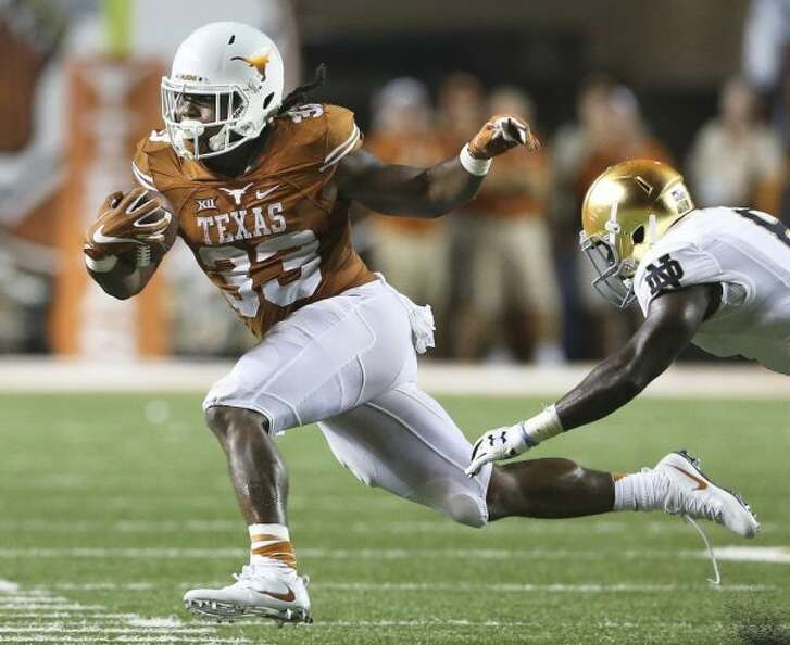 Longhorn running back D'Onta Foreman accelerates away from a tack let in the second half as Texas hosts Notre Dame at DKR Stadium on September 4, 2016.