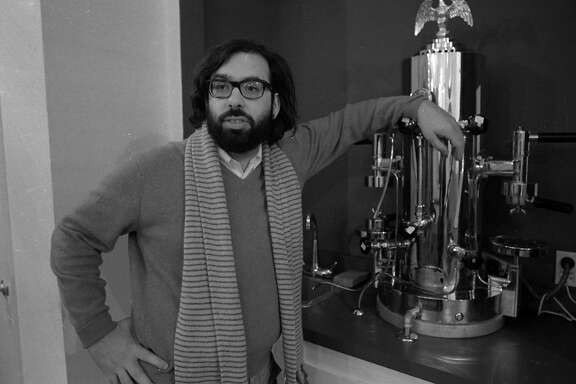 Dec. 10. 1969: Francis Ford Coppola poses next to his espresso machine at Zoetrope Studios on Folsom Street.