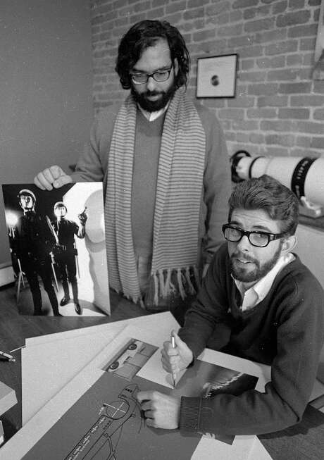 "Francis Ford Coppola (left) and George Lucas show some material from the American Zoetrope film ""THX 1138,"" directed by Lucas. Photo: Greg Peterson, The Chronicle"