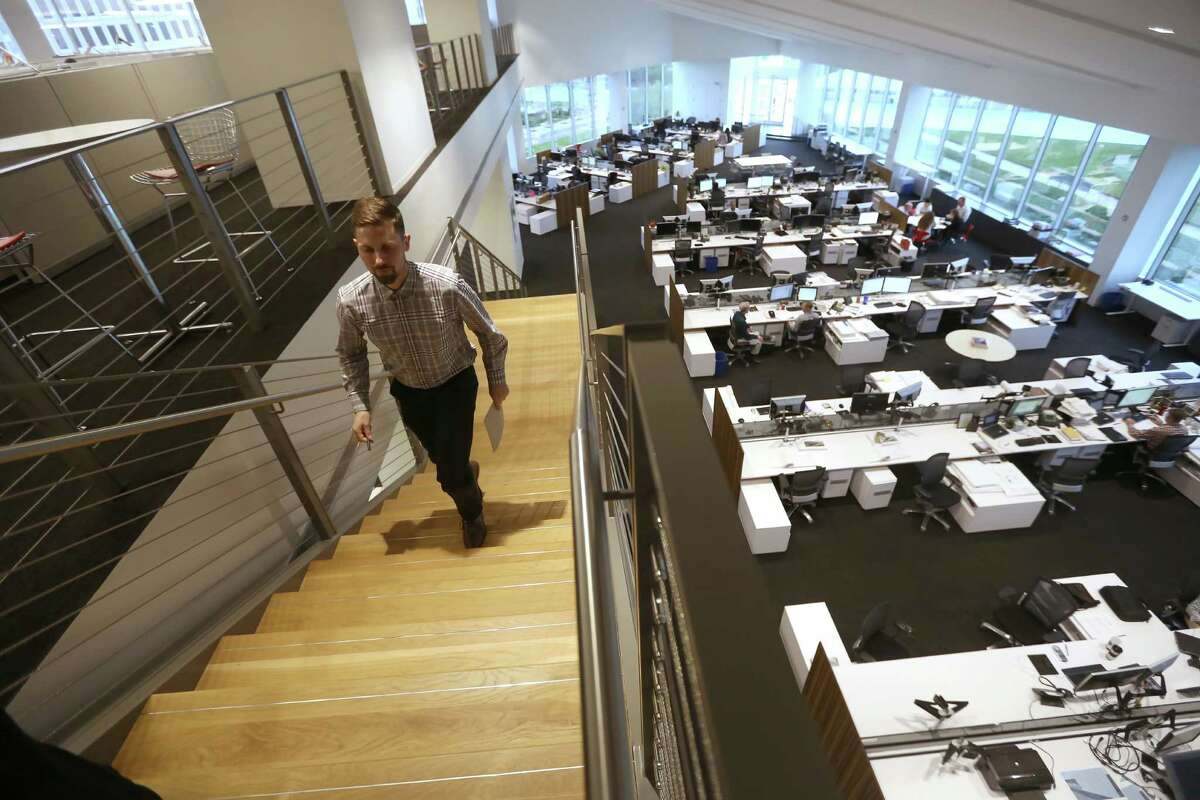 Stairs and showing the open work space at HOK, a global design, architecture, engineering and planning firm, Monday, April 11, 2016, in Houston, Texas. ( Gary Coronado / Houston Chronicle )