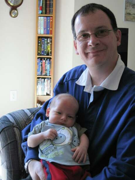 Peter Barrett, founder of Gone Not Gone, with his young son around 2010. Courtesy of Peter Barrett