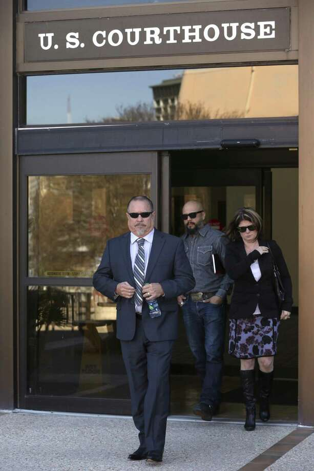 Bandidos motorcycle club president Jeff Pike, left, exits Wednesday, Nov. 30, 2016 the John H. Wood, Jr. Federal Courthouse in San Antonio after a hearing where the government claimed his attorney had a conflict of interest and sought to remove him. Photo: William Luther /San Antonio Express-News / © 2016 San Antonio Express-News