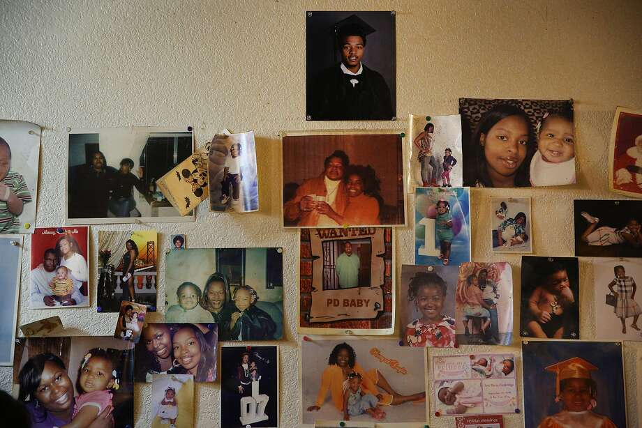 A graduation photo of homicide victim Roderick Travon Godfrey is at the top of family photos at his Oakland home. Photo: Santiago Mejia, The Chronicle