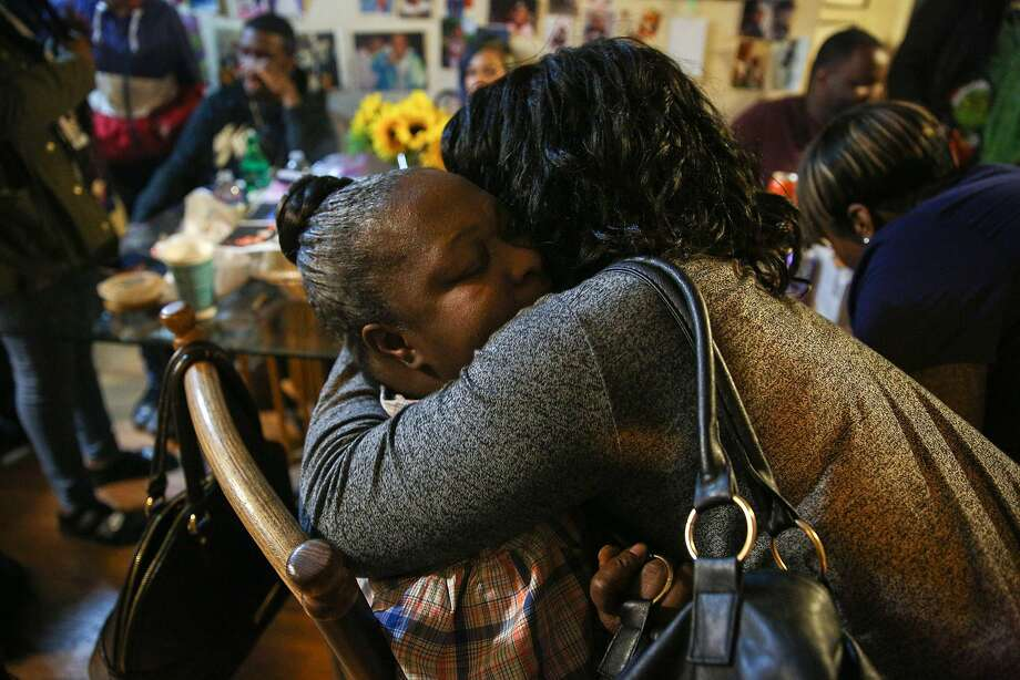 Facing towards camera: Teresa Jackson is embraced by Renita Lovette on Tuesday, Nov. 29, 2016 in Oakland, Calif. Jackson's son Roderick Travon Godfrey, age 19, was killed Monday when he and his friend Deante Antonio Miller, also age 19, were both shot multiple times at approximately 10:15 a.m. on the 700 block of 39th Street, between West Street and Martin Luther King Jr. Way, police said. Photo: Santiago Mejia, The Chronicle