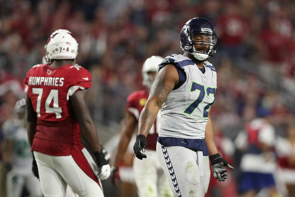 Defensive end Michael Bennett of the Seattle Seahawks reacts during the NFL game against the Arizona Cardinals at the University of Phoenix Stadium on October 23, 2016 in Glendale, Arizona. The Cardinals and Seahawks tied 6-6. (Photo by Christian Petersen/Getty Images)
