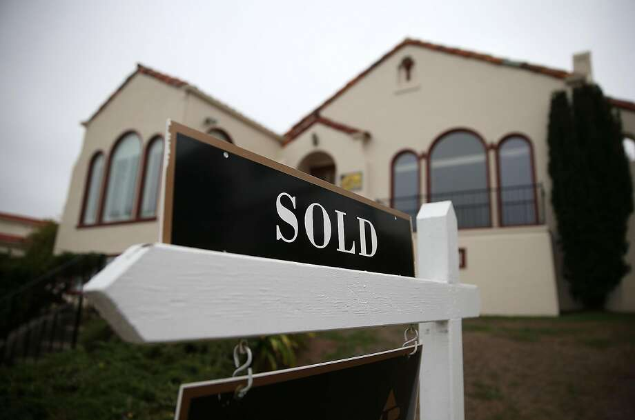 SAN FRANCISCO, CA - NOVEMBER 23:  A sold sign is posted in front of a home sale on November 23, 2015 in San Francisco, California.  According to the National Association of Realtors, sales of existing homes fell 3.4% in October from September to a seasonally adjusted annualized rate of 5.36 million.  (Photo by Justin Sullivan/Getty Images) Photo: Justin Sullivan, Getty Images