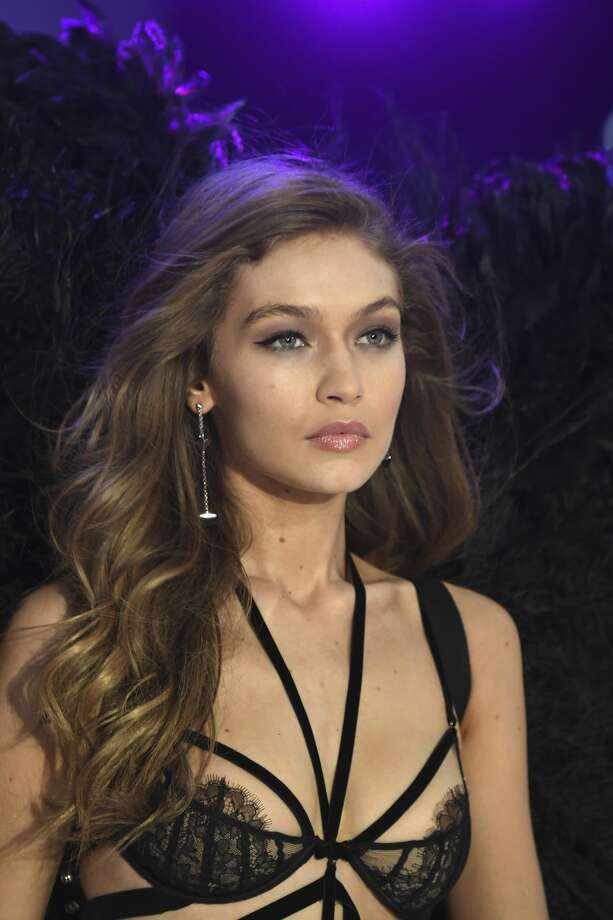 Gigi Hadid handles a wardrobe malfunction like a pro on the 2016  Victoria's Secret Fashion Show. Photo: Pascal Le Segretain/Getty Images For Victoria's Secret