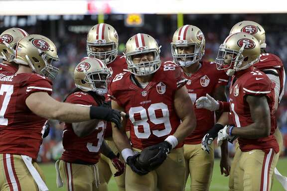 San Francisco 49ers tight end Vance McDonald (89) celebrates after scoring a touchdown against the New England Patriots during the first half of an NFL football game in Santa Clara, Calif., Sunday, Nov. 20, 2016. (AP Photo/Marcio Jose Sanchez)