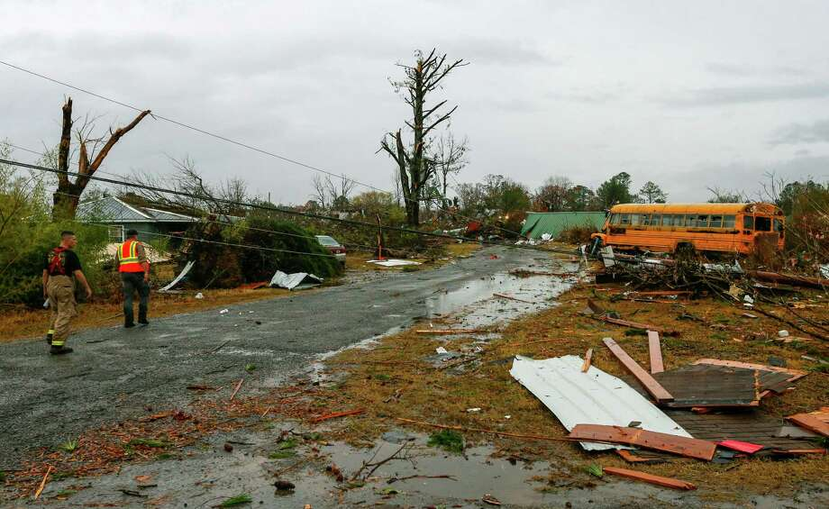 Rescue workers survey the damage after a suspected tornado ripped through the tiny town of Rosalie in northern Alabama on Wednesday.  Storms dumped 2 inches of rain, causing floods after months of drought. Photo: Butch Dill, FRE / Associated Press