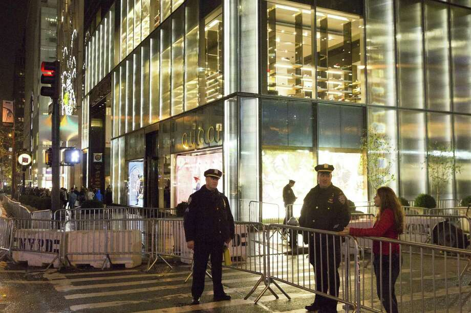 Security outside the Gucci store in Trump Tower, on Fifth Avenue in Manhattan, Nov. 25, 2016. Limited foot traffic was permitted to stores in the area on Black Friday. (Katherine Taylor/The New York Times) Photo: KATHERINE TAYLOR / NYT / NYTNS
