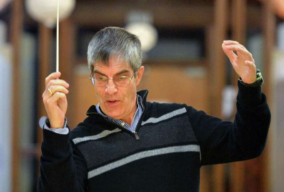 Stamford's Gunnar Sahlin conducts the Fairfield County Symphony Orchestra as they play a Hungarian waltz during practice at Temple Shalom on Tuesday November 29, 2016 in Norwalk Conn. Photo: Alex Von Kleydorff / Hearst Connecticut Media / Connecticut Post