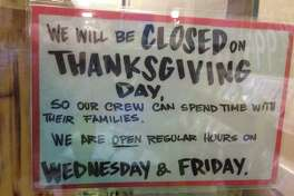 A sign at the Trader Joe's grocery store, Shepherd and W. Alabama, alerts shoppers that it will be closed for Thanksgiving 2014. (Chronicle File Photo)