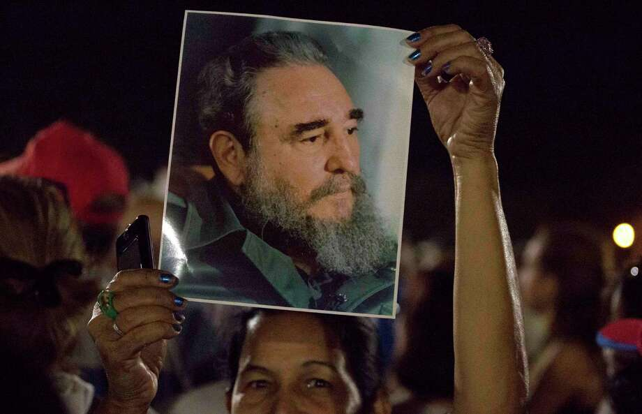 A woman holds a picture of late Fidel Castro during a rally at Revolution Plaza in Havana, Cuba, Tuesday, Nov. 29, 2016. Schools and government offices are closed Tuesday for a second day of homage to Castro, with the day ending in a rally on the plaza where the Cuban leader delivered fiery speeches to large crowds in the years after he seized power. Castro died Nov. 25 at age 90. (AP Photo/Desmond Boylan) Photo: Desmond Boylan, STR / Copyright 2016 The Associated Press. All rights reserved.