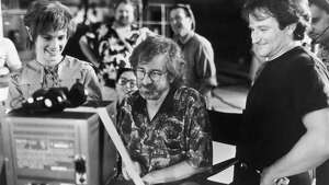 Actors Julia Roberts and Robin Williams watch daily production footage with director Steven Spielberg on the set of his film, 'Hook,' 1991. (Photo by Columbia Tristar/Getty Images)