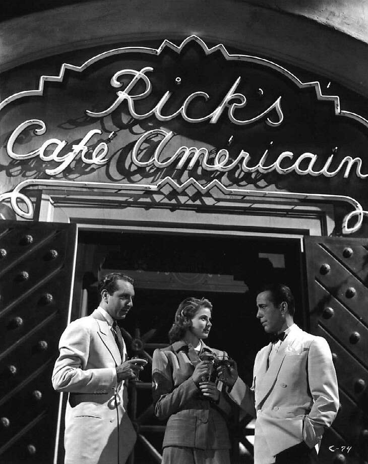 "Paul Henreid (left), Ingrid Bergman and Humphrey Bogart in ""this crazy world"" of ""Casablanca."" Photo: AP"
